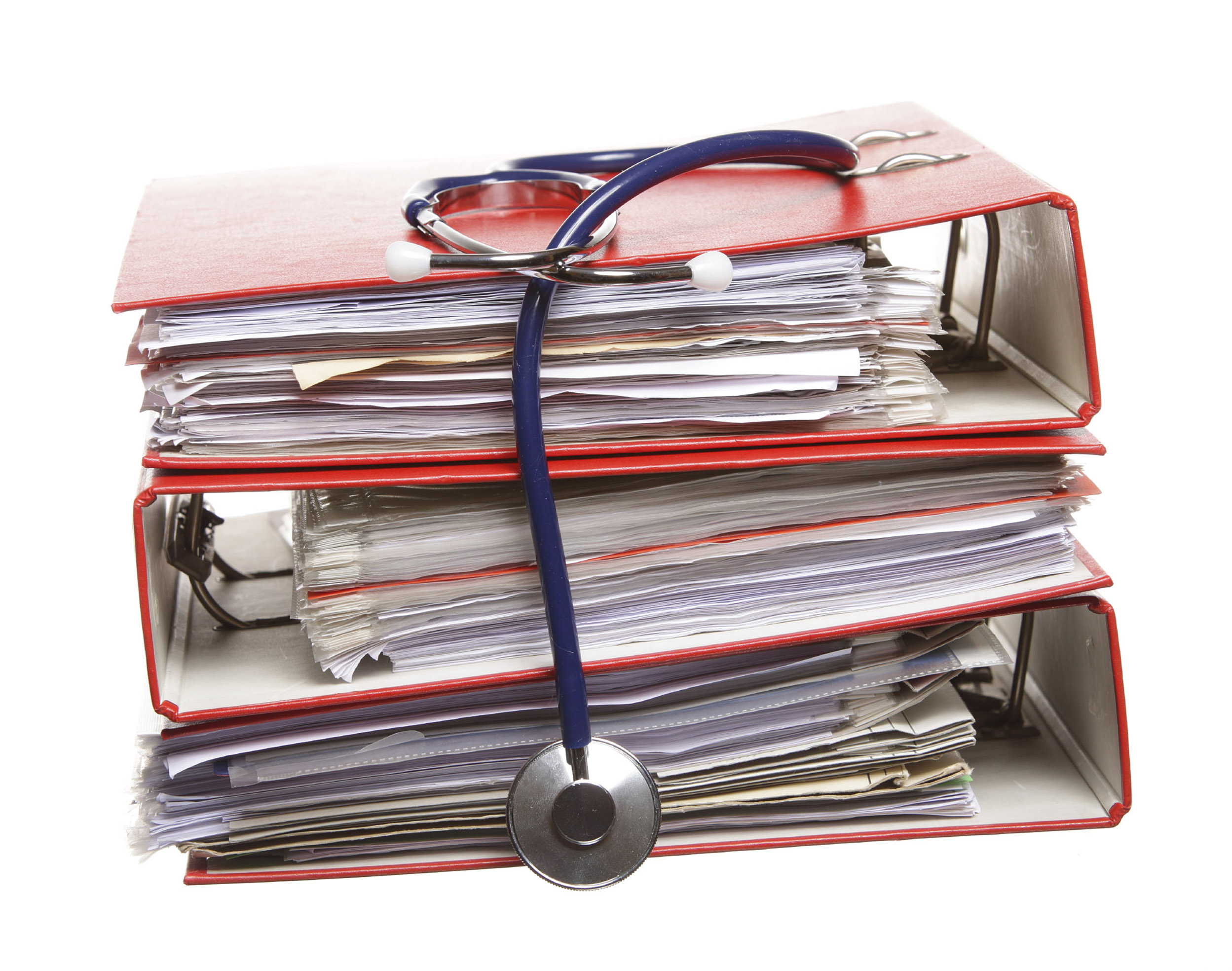 Overflowing binder of Doctors notes